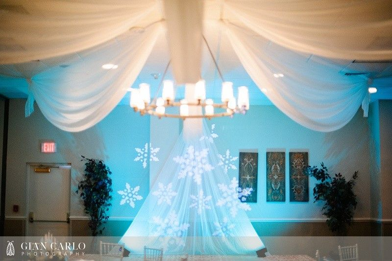 teal uplighting with blue snowflake lights