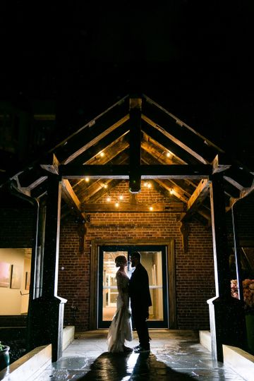Newlyweds by the entrance | STUDIO 1 PHOTOGRAPHY