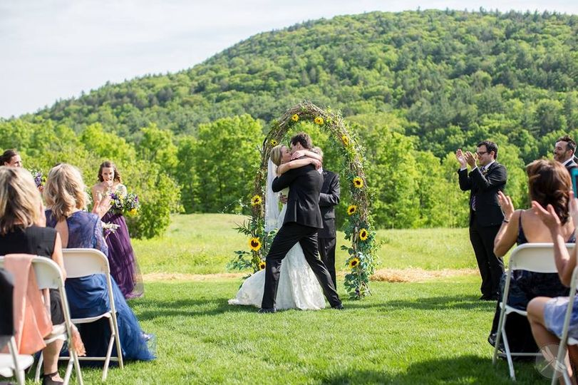 Beautiful ceremony at the Montague Retreat Center.  Photo by Four Wings Photography