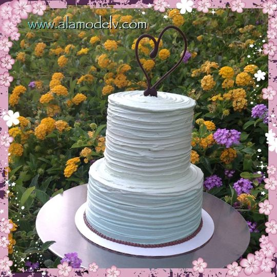 A subtle teal ombré two tiered cake complete with brown accents. Picture perfect!   All of our...