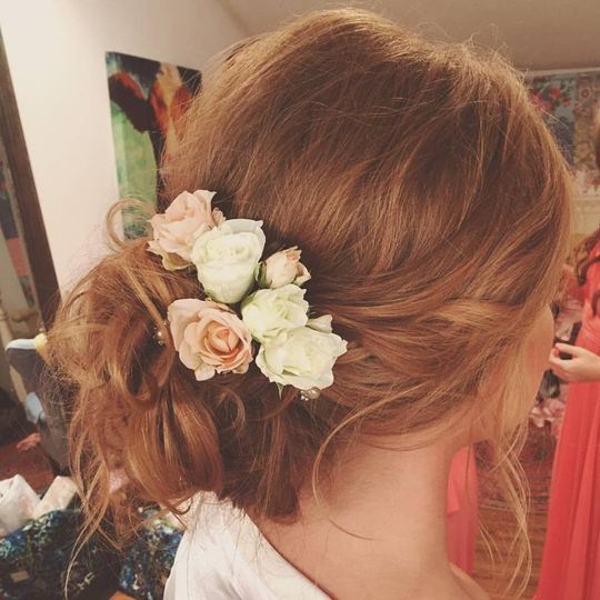 Messy bun with floral accessories