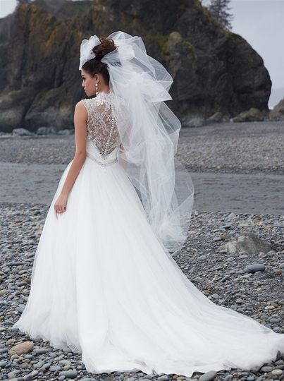 This is truly the ballgown of a princess - a gauzy tulle skirt topped with an incredibly gorgeous...
