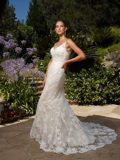 Beaded lace appliqués on Point D'esprit over Luxe Satin gown. Beaded lace appliqué is accented with...