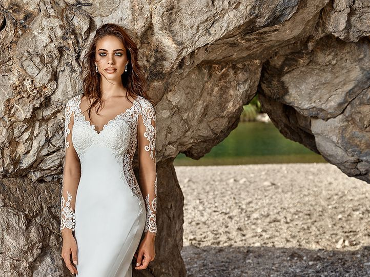 A stunning Eddy K gown with long sleeves and lace applique. Crepe material and full lace illusion...