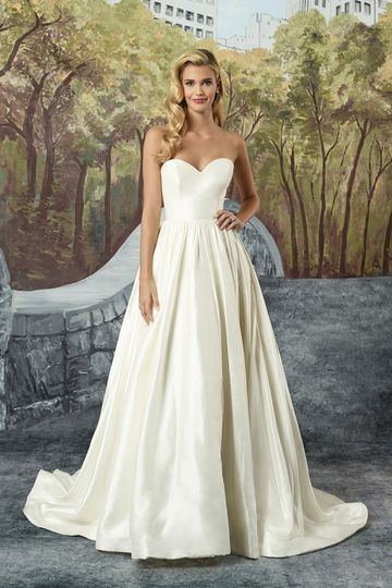 An elegant Silk Dupion ball gown with piped neckline and waistline, full gathered skirt, and pockets...