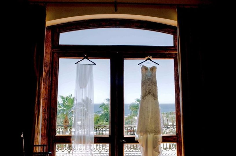 Dress hung by the window