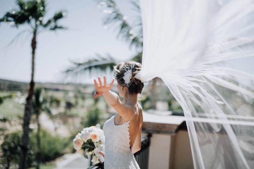 Bride flipping her veil
