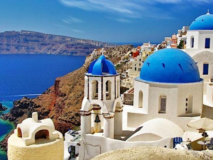 Tmx 1457450373532 Greece Santoriniviewofcalderawithdomesheader Noblesville wedding travel