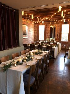 Rustic chairs and table garlands
