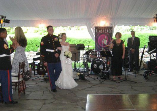 The bridal party enters the reception as Donna Mark provides the announcements of each couples' name...