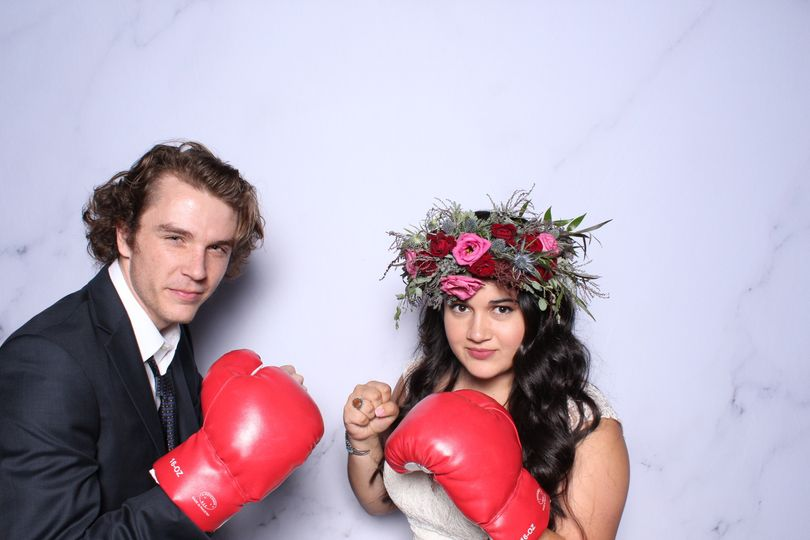Newlyweds with boxing gloves