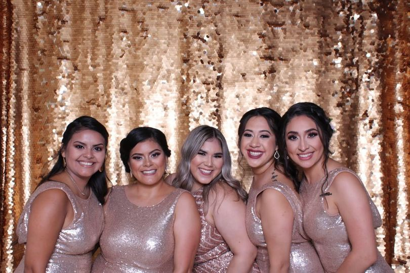 Gold backdrop for the bridesmaids