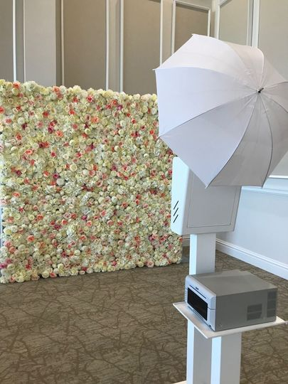 Booth setup with flower wall