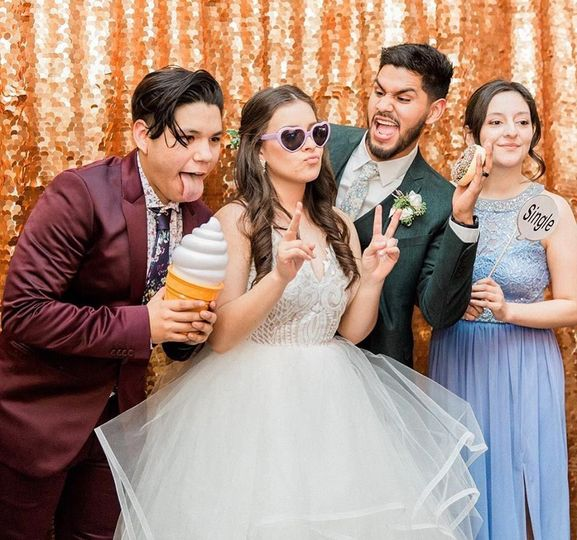 Newlyweds with the maid of honor and best man
