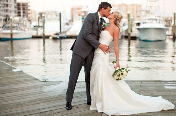 Couple kiss by the dock