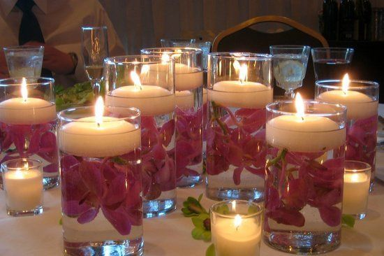 Ivory Floating Candles with Orchids in tall Candle Vases