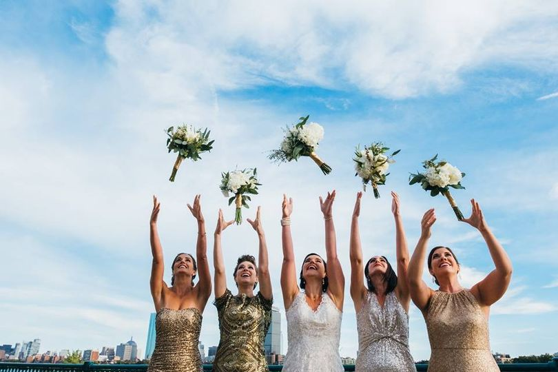 Bridal party toss their bouquets