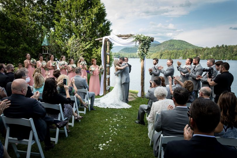Lakeside ceremony under the arbor