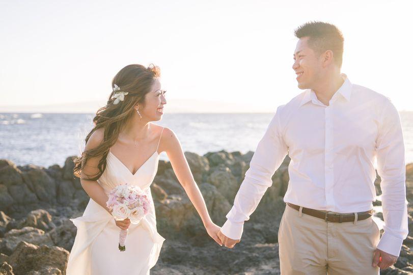 Laughing during a Maui beach wedding