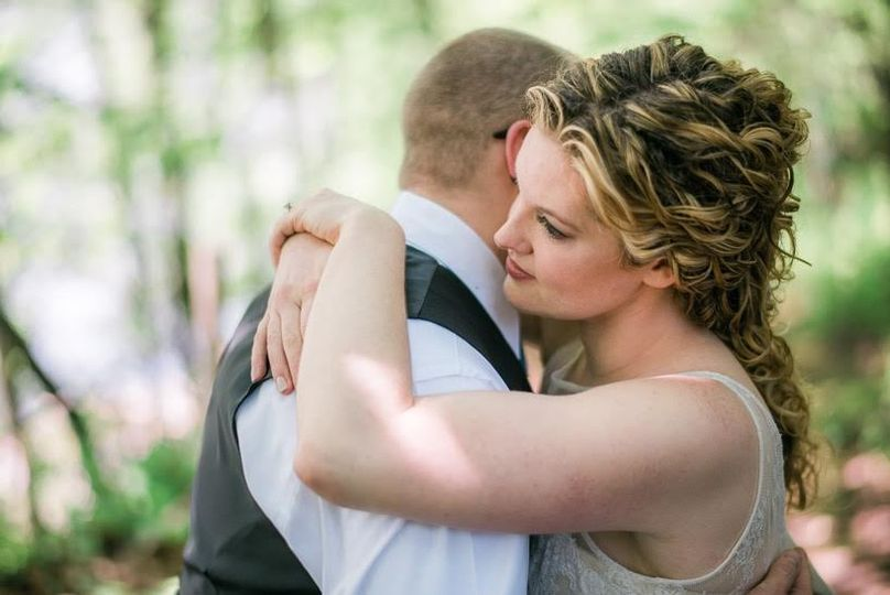Newlyweds hugging each other