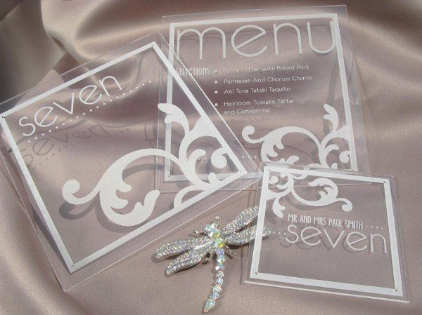 Acrylic plexiglass menu, table number and place card with custom typography and design etching