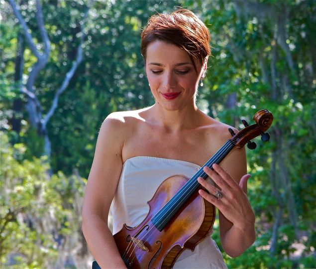 Danijela holding her violin