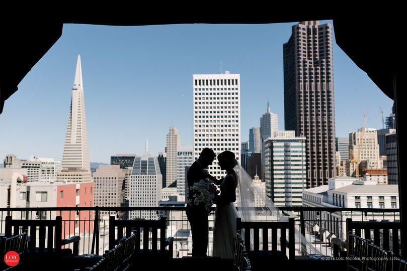 Newlyweds overlooking the city