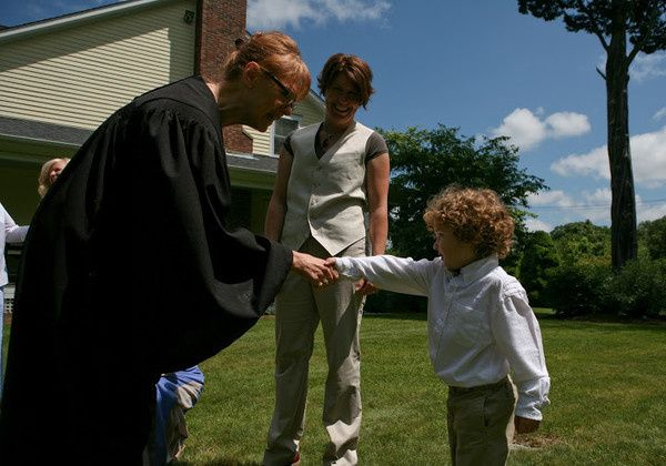 Officiant shaking hands with the child