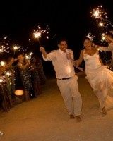 thumbsbarefoot on the beach wedding sparklers
