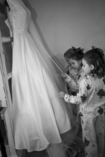 Kids touching the bridal dress