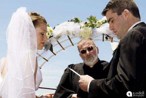 Reverend at a beach wedding