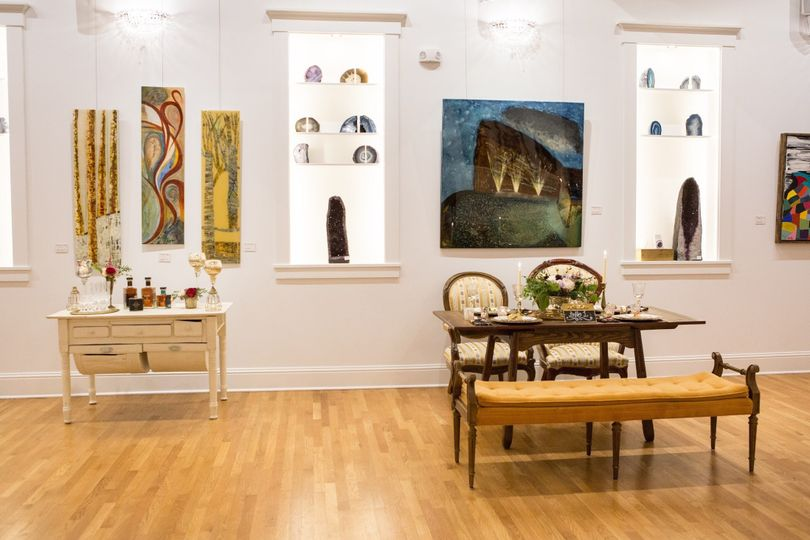 Beautiful art hangs on the walls of Gallery 1874