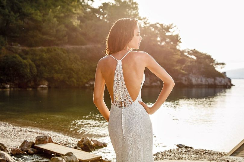 Bride posing by the lake