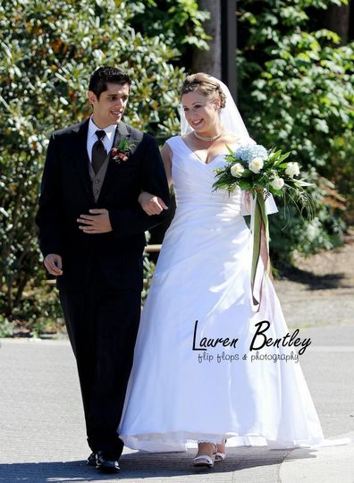 Bride and groom walk for formal portraits
