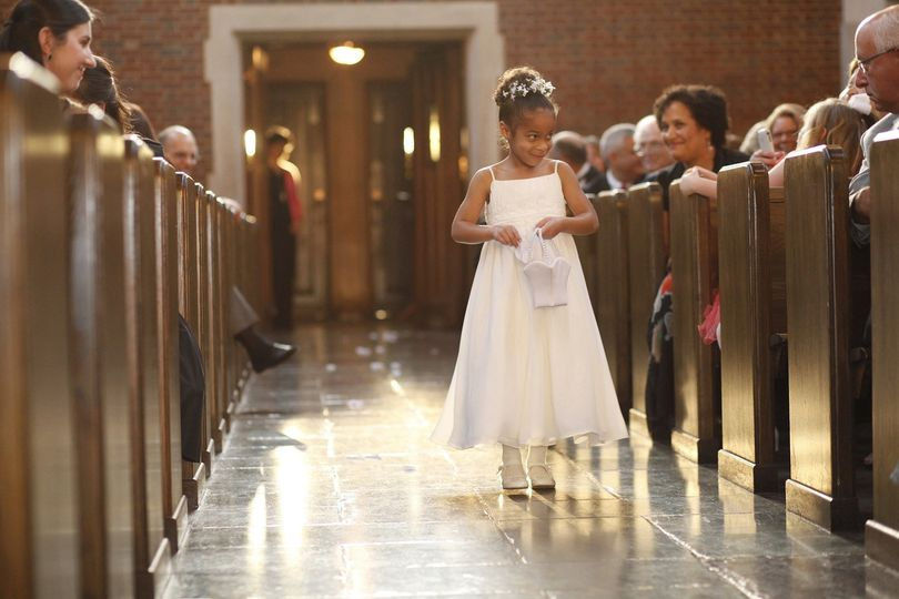 Beautiful flower girl walks the 90 foot center aisle of Wightman Chapel at Scarritt-Bennett.  Photo:...