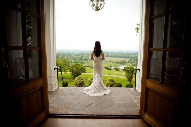 The bride on manor front porch