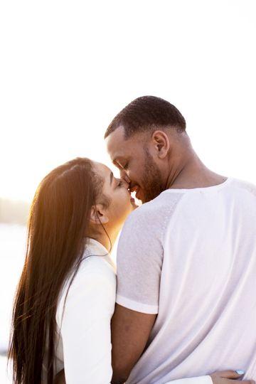 Candid couple kiss