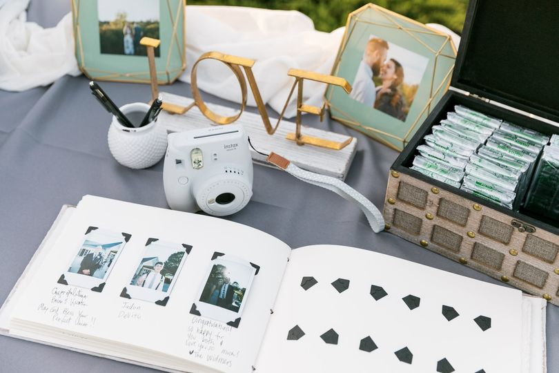 Guest book featuring an instant camera