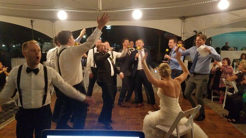 Groomsmen serenading the bride