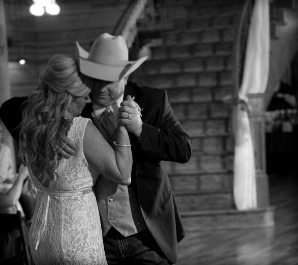 Dancing with his bride.