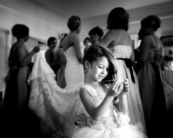 flower girl smiling at locket before wedding raya
