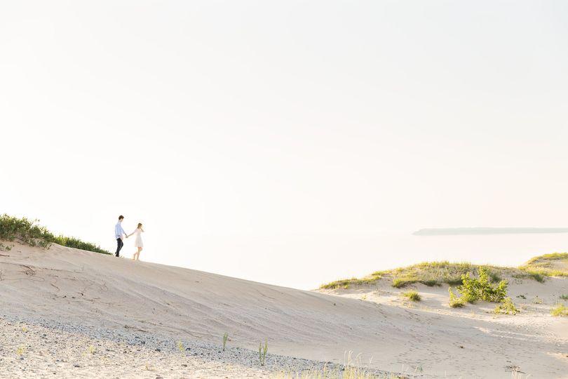 engagement photo at sleeping bear dunes rayan ana