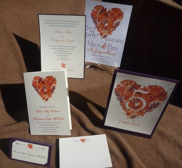 We custom created a heart of fall foliage for this October bride using her colors of aubergine and...