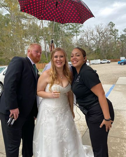 Protecting the bride from rain