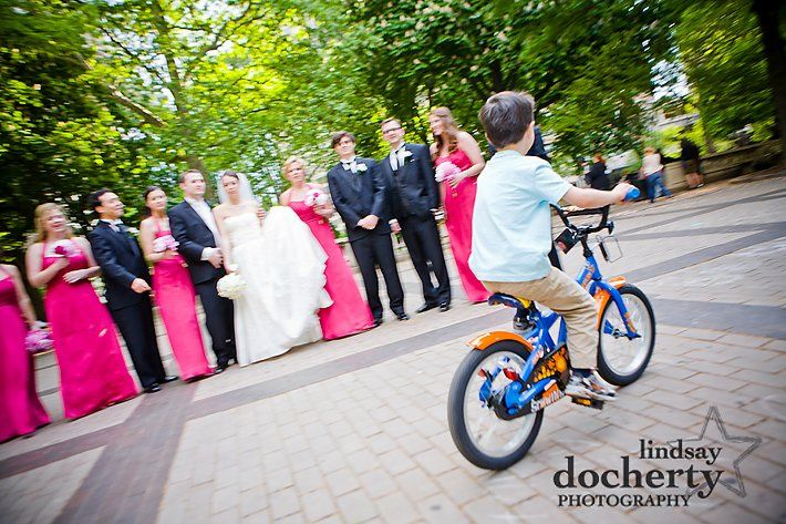 Wedding party + mini photo bomber in Rittenhouse Square
