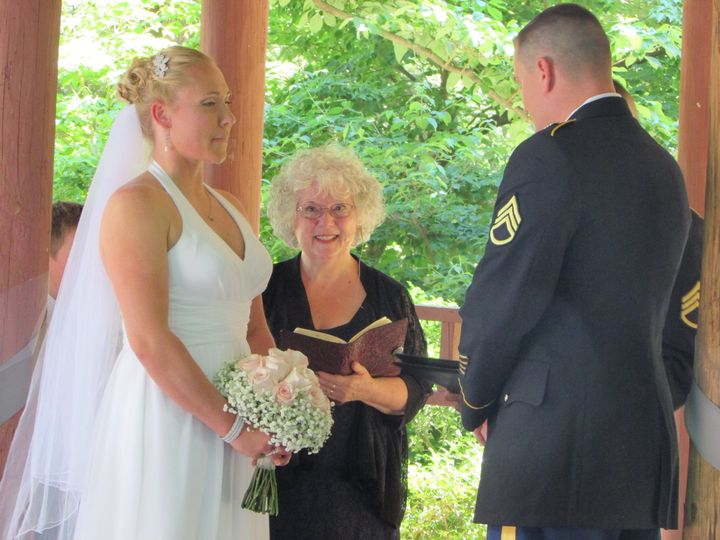 CT officiant Zita Christian with bride and groom, both active military, at their wedding in Wickham...