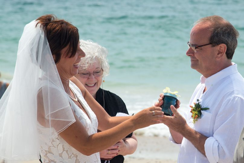 CT officiant Zita Christian guides Leslie and Chuck in a wedding ritual blending sand from...