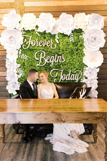 Flower Wall with Couples Table
