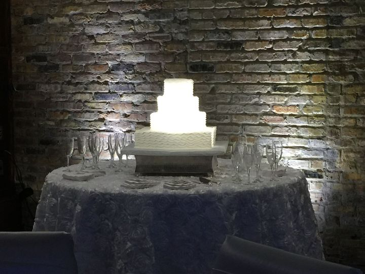 Pin Spot lighting on the wedding cake brings it out of the shadows and showcases it.