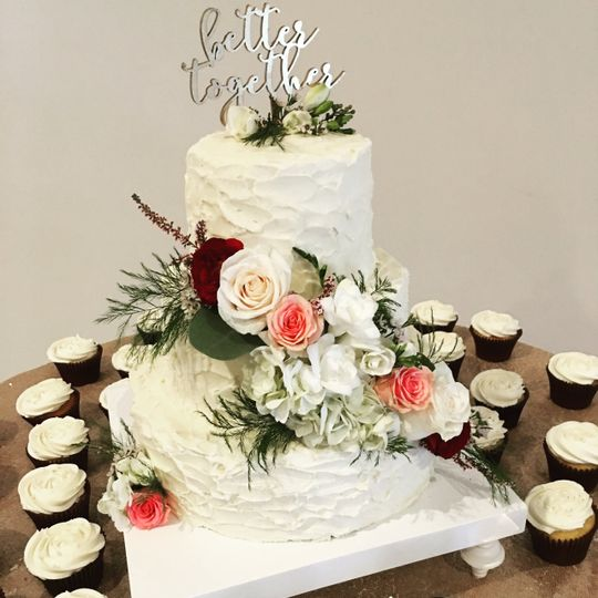 Wedding cake and cupcakes with white flowers